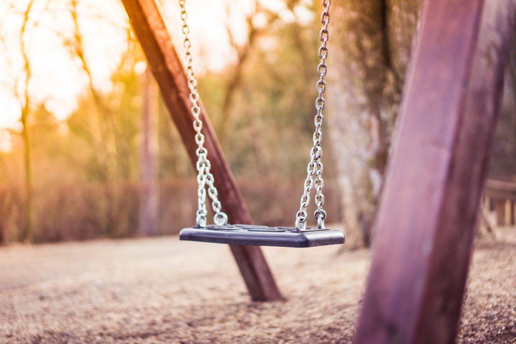 swing-for-kids-in-city-park-playground-2-picjumbo-com